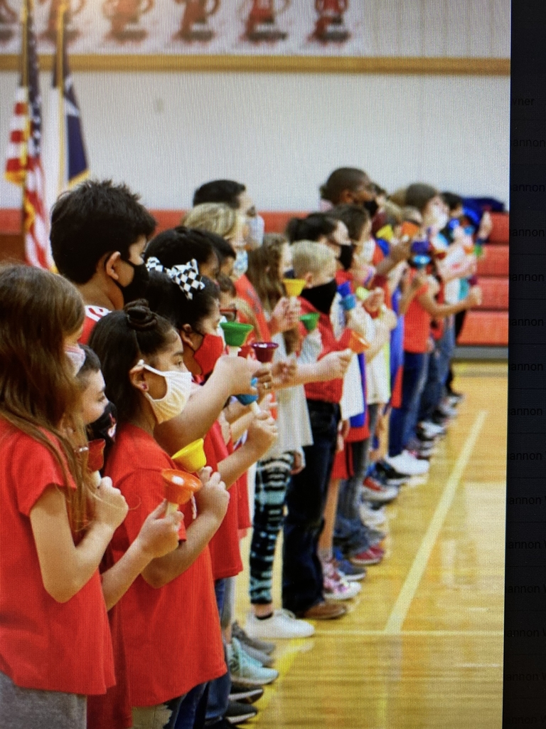 Fourth graders performing at Veteran's Day Program